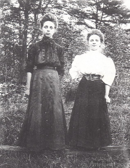 Two young women in long skirts