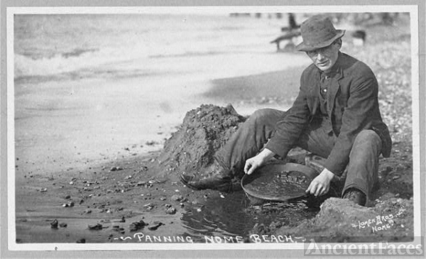 Man panning gold on Nome Beach