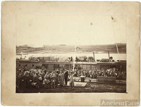 Party of exiles and convicts embarking on river barge at...