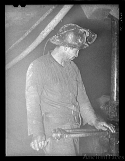 Gold miner operating pneumatic drill. Mogollon, New Mexico