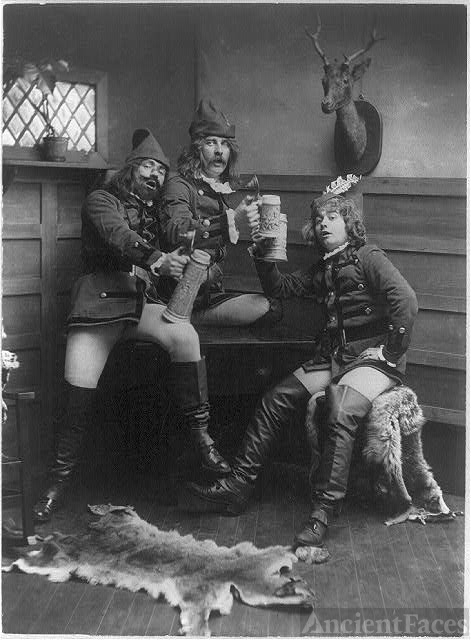 [Three men in German student uniforms lifting beer steins]