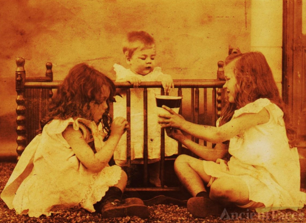 Three girls with crib and cup
