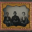 Civil War Infantryman Between Two Women (Possibly Relatives)