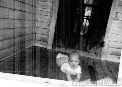 Baby on front porch.