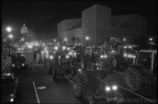 [Farmers driving tractors at night on Pennsylvania...