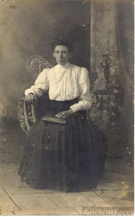 Woman in Chair, with Book