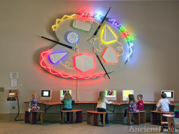 Children learn art from computers at the ArtWorks center...