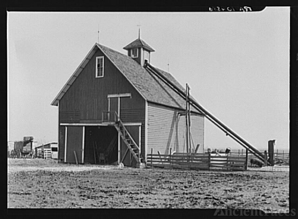 Corn crib on the owner-operated farm of Mary Lah, two...