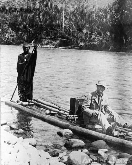 [Explorer, with Indian, on raft, in the Amazon Jungle,...