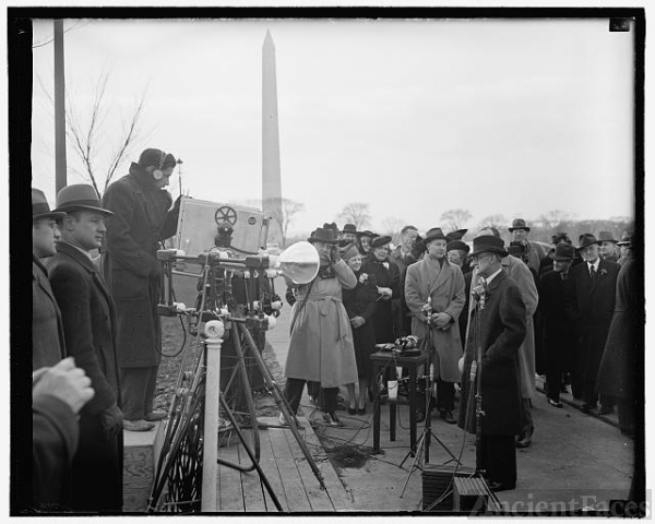 FCC Chairman faces lens of television camera. Washington,...