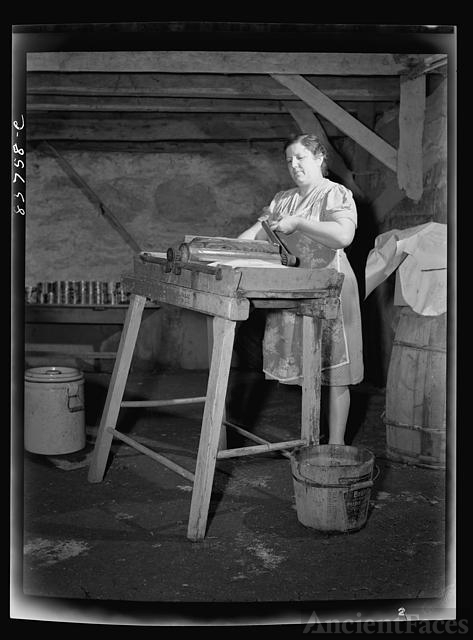Fort Kent, Maine (vicinity). Mrs. Gagnon wringing water...