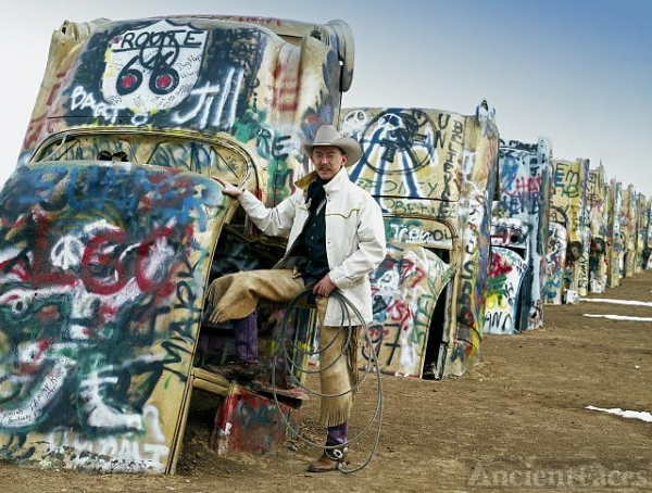 Cowboy at the funky Cadillac Ranch, U.S. Route 66,...