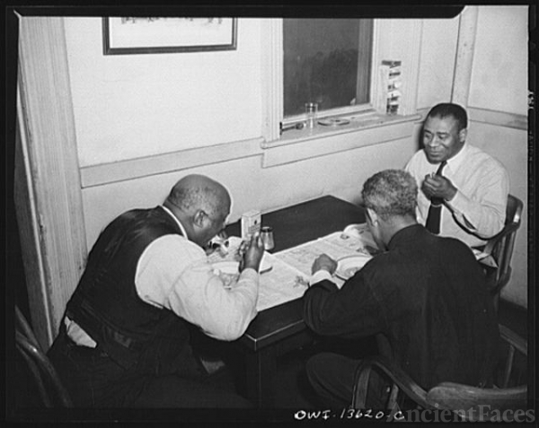 Washington, D.C. Firehouse Station No. 4. Fireman eating...