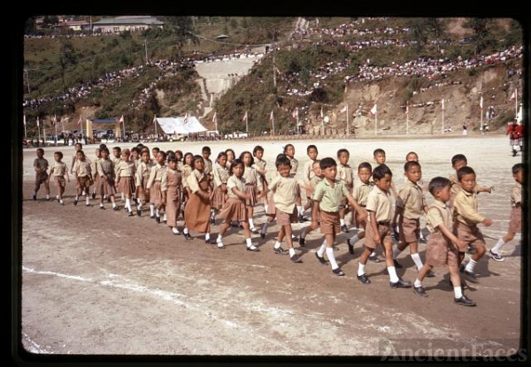 [School children lining up for the birthday parade in...