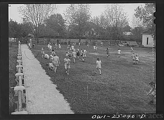 San Augustine, Texas. Easter egg hunt on the school lawn...