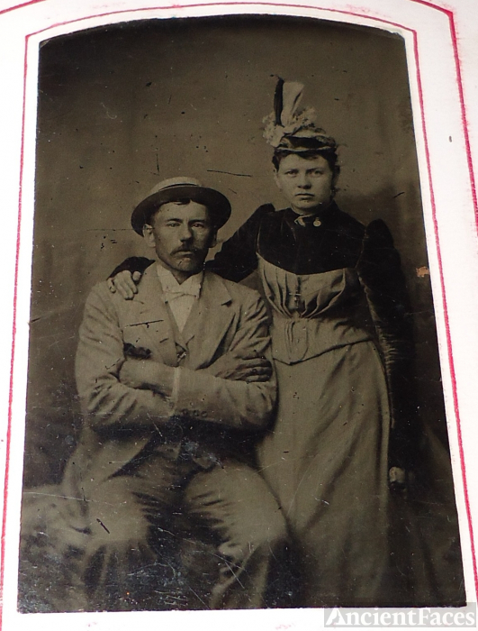 Unknown couple with hats