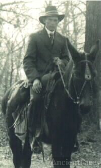 James H. McElroy and horse