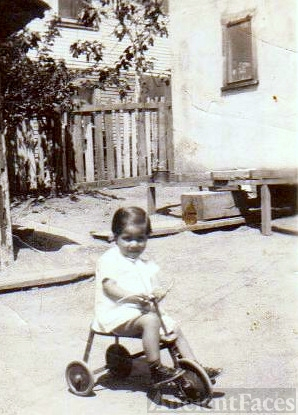 Virginia Espinoza on a tricycle