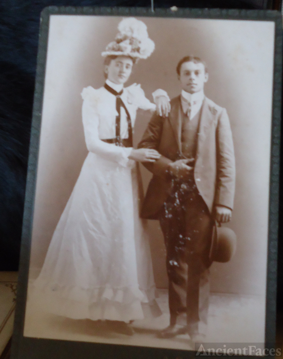 Unknown couple & hat