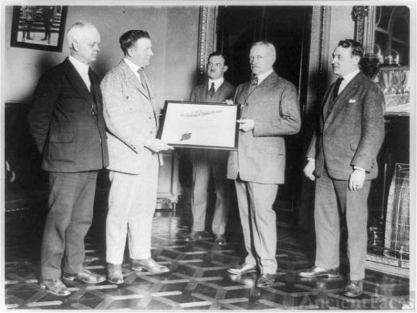[John J. Pershing and another man holding certificate of...