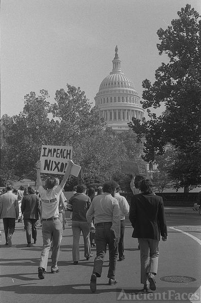 "[Demonstrators with ""Impeach Nixon"" sign near the U.S...."