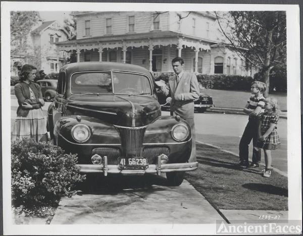 1941 Ford and a family