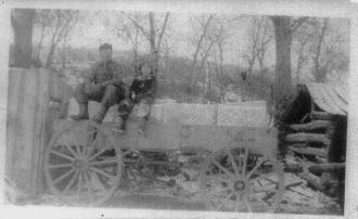 Alfred and unknown person in wagon