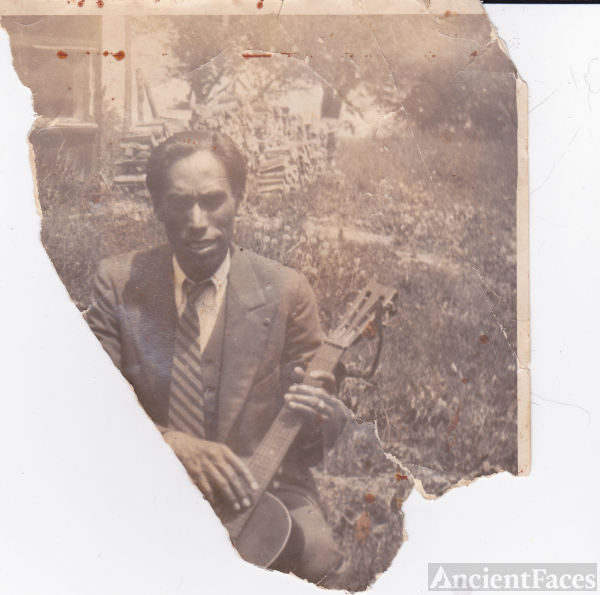 African - American Man with Guitar