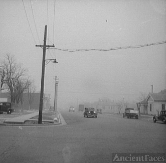 Texas autos driving through dust storm, 1936