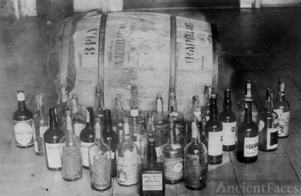 Bottles and barrel of confiscated whiskey