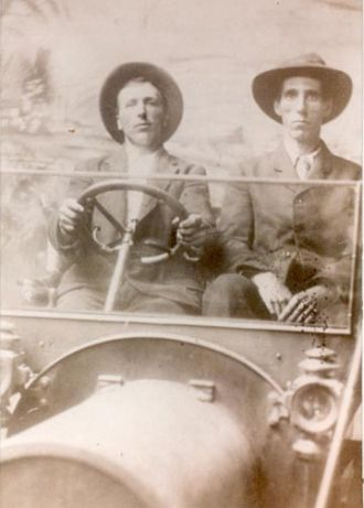 Charley Dulaney (driving) and Willie Jackson Sowers