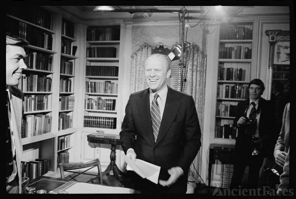 [President Gerald Ford standing and smiling after giving...