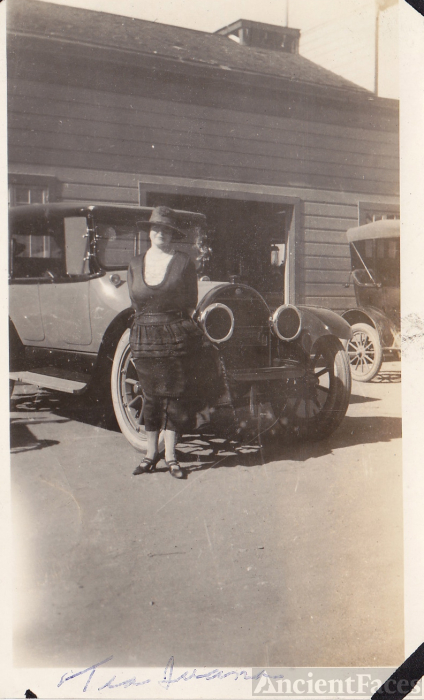 Woman in front of antique car