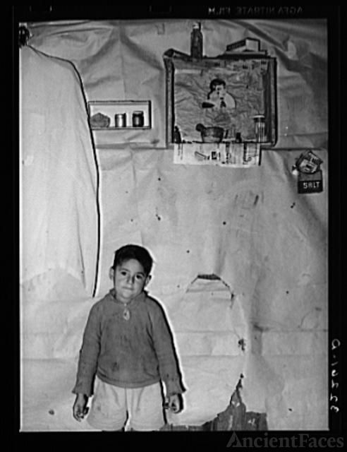 Mexican boy living in corral, Robstown, Texas. Notice the...
