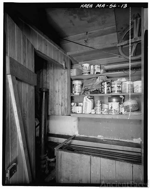 13. VIEW OF ELEVATOR MACHINE ROOM WITH CABINET AND CLOSE...