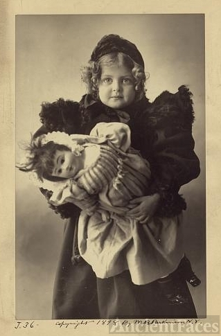Unknown girl and doll