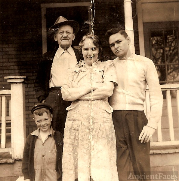 Loyd with wife Bertha, their son Bob Clark and boy unknown