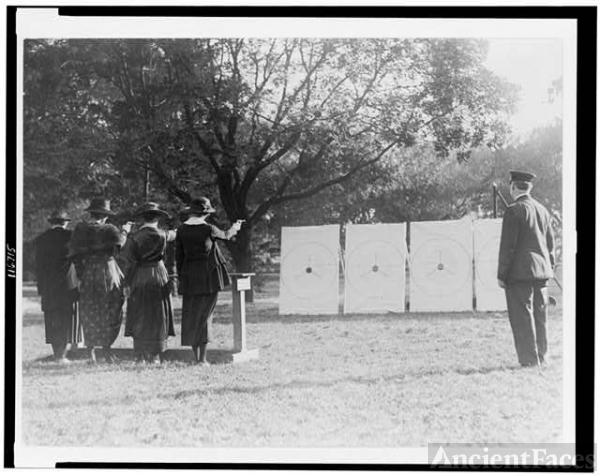 [Four policewomen shooting at targets, as a policeman...
