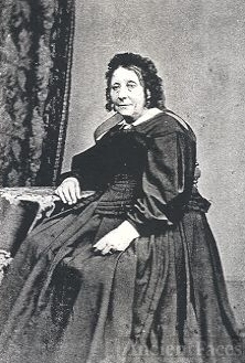 Kind-faced English Matron seated