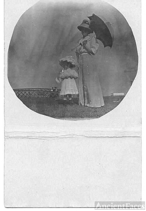 Lady with umbrella and child