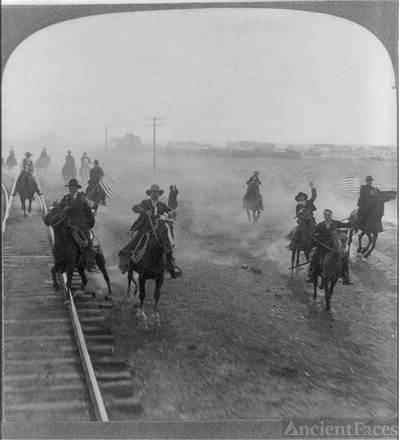 Cowboys following Teddy Roosevelt's Train