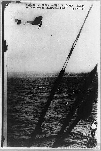 [Louis Blériot in his plane over the cliff of Dover,...