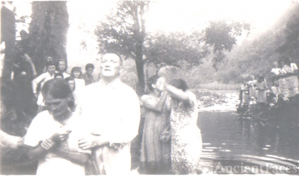 BAPTISING AT THE RIVER 2
