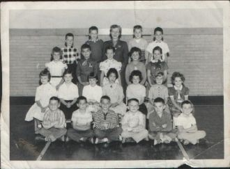 A photo of Front Row Left 1st of 6 Unknown Male Students