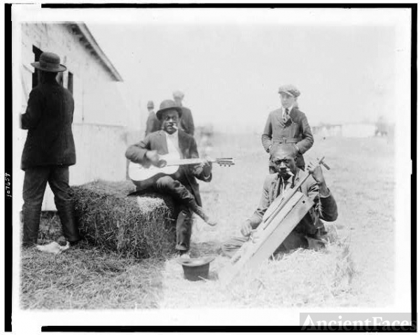 [Two Afro-American men, outside of stable, with Kazoos in...
