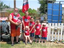 My brother and his 5 grandson's on the 4th of July 2010 and his lil dog gg