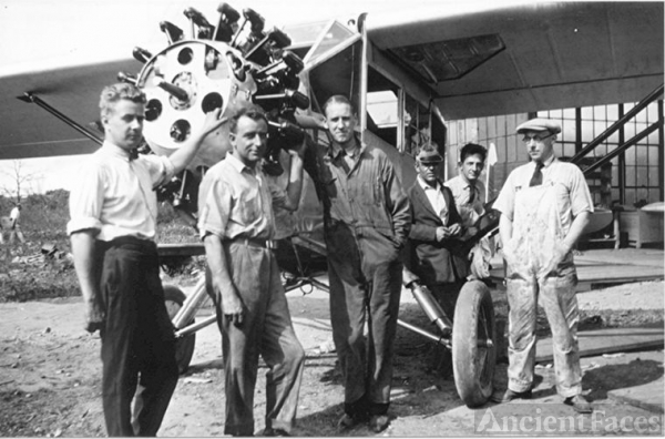 Men with plane at Mitchell Field 2
