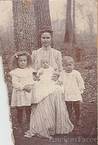 "Laura ""Blair"" Yarbrough and children, Lula, Jack (on lap) and Johnie"