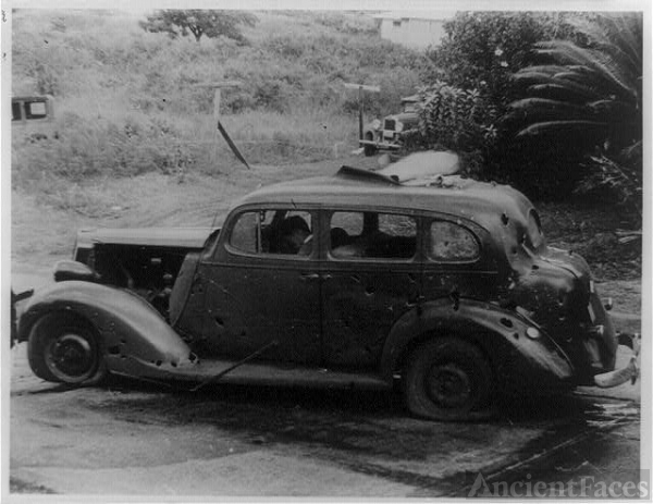 Three civilians were killed in this shrapnel-riddled car...