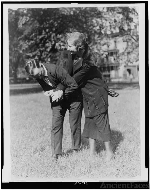 [Policewoman and policeman practicing self-defense]